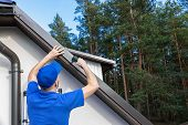 Roofer Installing Metal Drip Edge Profile On The House Roof poster