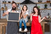 Cooking Together. Family Mom Dad And Daughter Wear Aprons Stand In Kitchen. Cooking Food Concept. Pr poster