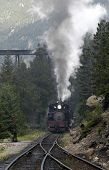 image of chug  - an old steam locomotive chugs up the mountain pass in the morning fog - JPG
