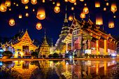 Yee Peng Festival And Sky Lanterns At Wat Phra Singh Temple At Night In Chiang Mai, Thailand. poster