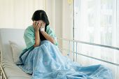 Asian Young Woman Patient Lying At Hospital Bed Feeling Sad And Depressed Worry. Disease Feeling Sic poster