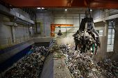 Mechanical Claw Hand Grabbing Pile Of Mixed Waste, Deposited In The Waste Treatment Plant Depot, Pre poster
