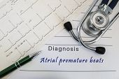Diagnosis Of Atrial Premature Beats. Stethoscope, Green Pen And Electrocardiogram Lie On Medical For poster