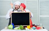 Tasty Cooking Class. Couple Of Man And Woman Giving Ok Sign At Blackboard In Cooking School. Master  poster