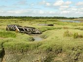 Salt marsh with old wooden boat