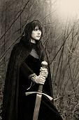 stock photo of guardian  - Portrait of a medieval lady with sword  - JPG