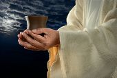 picture of communion-cup  - Jesus hands holding cup with night background - JPG