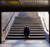 stock photo of hobo  - Lonely man sitting on the stairs - JPG