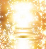 stock photo of gold glitter  - yellow sunrise with some sparkles around it - JPG