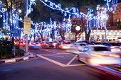 Orchard Road, Singapore. The street and buildings with lights and decorative items in preparation for Christmas. motion blurred