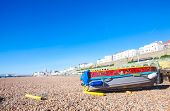 BRIGHTON, UK - FEBRUARY 8, 2011: Old boat on Brighton's pebble beach on February 8 2011 in Brighton,