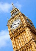 image of church-of-england  - Close up of Big Ben Clock Tower Against Blue Sky England United Kingdom - JPG