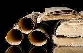 image of bookworm  - Many scrolls and old books on black - JPG