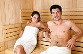 stock photo of sauna  - Beautiful couple relaxing while taking a sauna - JPG