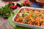 stock photo of jalapeno peppers  - dish with traditional mexican food enchiladas - JPG
