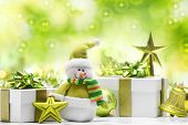 stock photo of snowman  - Snowman and gift boxes on abstract background - JPG