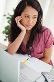 Bored brunette student at her desk