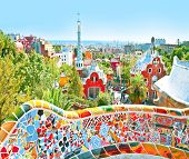 The Famous Summer Park Guell over bright blue sky in Barcelona, Spain