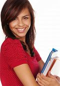 Attractive young student going back to school college smiling and holding books.