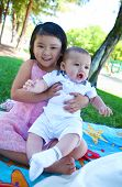 A cute asian girl with boy in the park