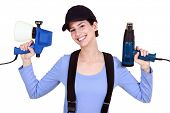 Woman holding paint sprayer and heat gun