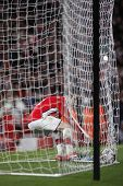 LONDON, ENGLAND. 31/03/2010. Arsenal's Cesc Fabregas picks the ball out of the net after scoring dur