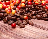 Coffee beans on wooden background.