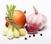 Garlic clove and onion on white background