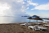 Great beach with dramatic sky in Bodrum Turgutreis, Turkey.