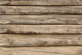stock photo of log fence  - Wooden wall assembled of beams or logs - JPG