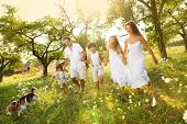 foto of father time  - Happy young family spending time outdoor on a summer day