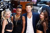 NEW YORK-JULY 30: Singer Robin Thicke performs on NBC's Today Show at Rockefeller Plaza on July 30, 2013 in New York City.