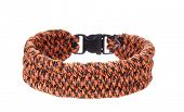 stock photo of paracord  - Paracord survival Bracelet using a ladder weave in a leopard cord - JPG