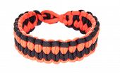 stock photo of paracord  - Paracord survival Bracelet using a Blaze weave in Blaze orange or hunter orange and black cord - JPG