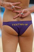 12/08/2011 LONDON, ENGLAND, Brittany Hochevar (USA) signals her partner during the FIVB International Beach Volleyball tournament, at Horse Guards Parade, Westminster, London.