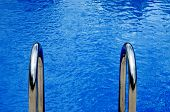 close-up of a swimming with a metallic ladder