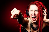 Expressive girl rock singer with great red dreadlocks.