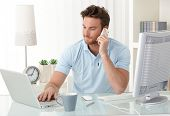 image of people talking phone  - Casual businessman working at office desk - JPG
