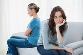 picture of not talking  - Angry women after a fight not speaking sitting on the sofa - JPG