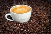 Cup Of Morning Espresso In Dark Roasted Coffee Beans