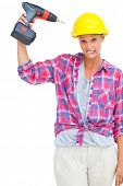 Attractive handy woman holding a power drill on white background