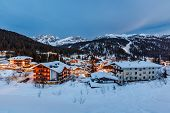 Illuminated Ski Resort Of Madonna Di Campiglio In The Evening, Italian Alps, Italy
