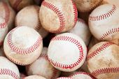 foto of stitches  - closeup of old used dirty practice baseballs