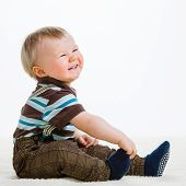 stock photo of suspenders  - Baby boy 16 Months old wearing striped shirt and suspenders white background - JPG