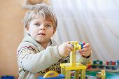 Little Toddler Boy Playing With Wooden Toy, Indoors