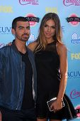 Joe Jonas and Blanda Eggenschwiler at the 2013 Teen Choice Awards Arrivals, Gibson Amphitheatre, Uni