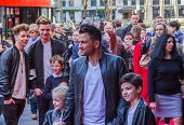Peter Andre posing for photographers with his children
