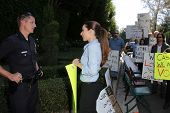 Kerri Kasem talks to the police at a protest involving Casey Kasem's children, brother and friends w
