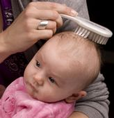 Mother Combing Baby Hair