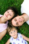 stock photo of family fun  - Family outdoors on lawn on a sunny day - JPG